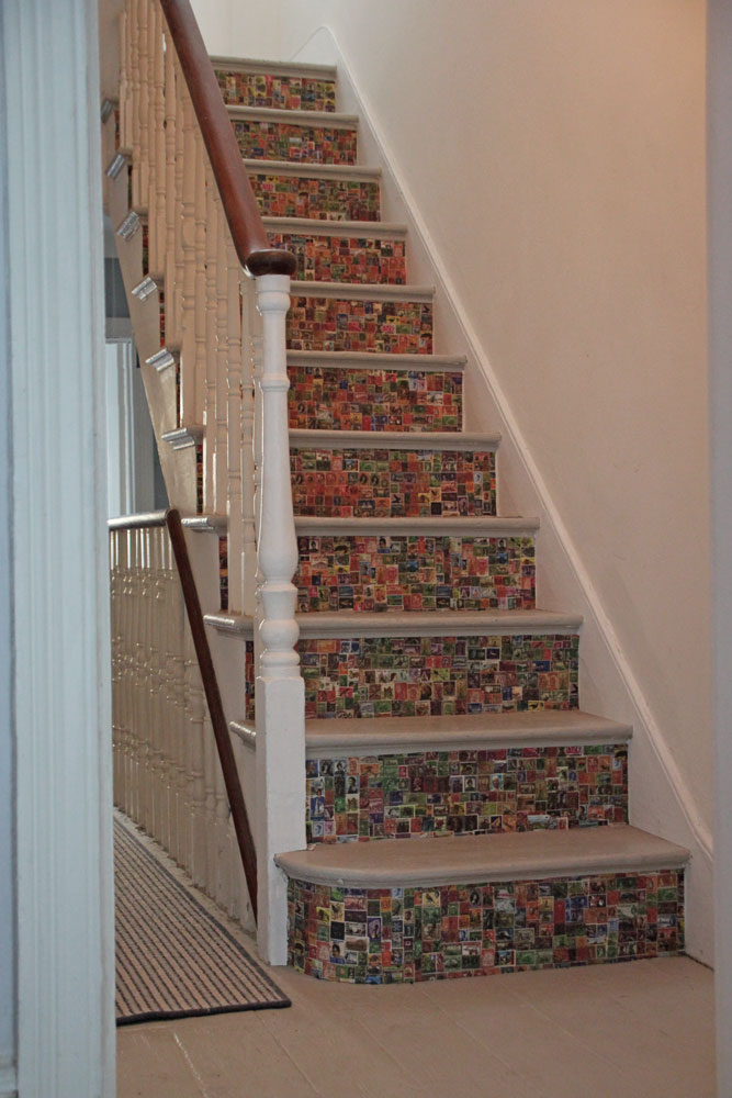 A white staircase with wallpapered risers